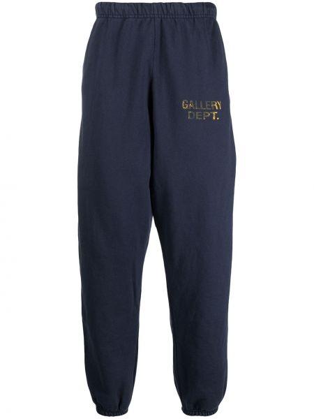 Niebieskie spodnie bawełniane z printem Gallery Dept.