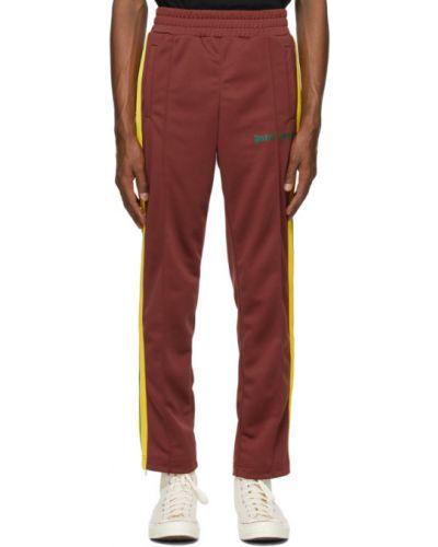 Czerwony spodnie z kieszeniami z mankietami Palm Angels