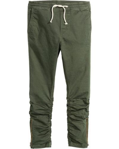 Зауженные брюки на резинке хаки H&m