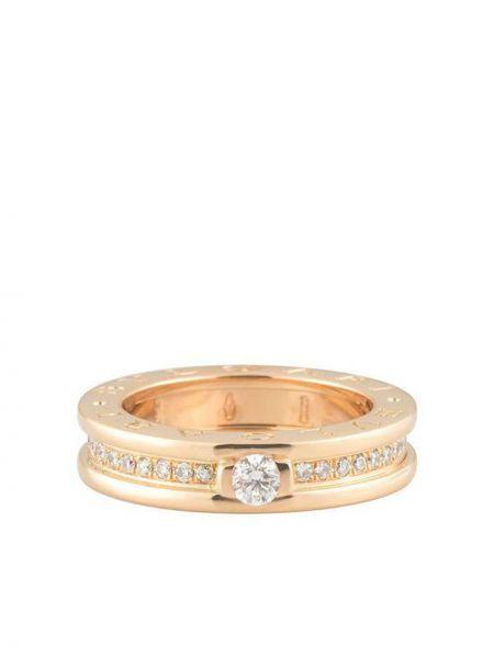 Розовое кольцо с бриллиантом круглое Bvlgari