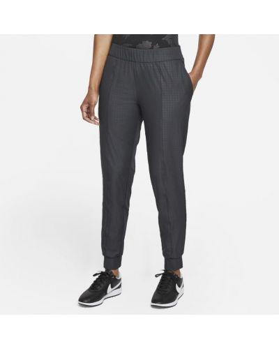 Spodnie w kratę Nike