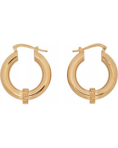 Серьги-гвоздики золотые Versace