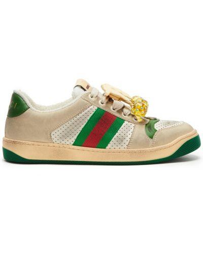 Кожаные кроссовки бежевые с перфорацией Gucci