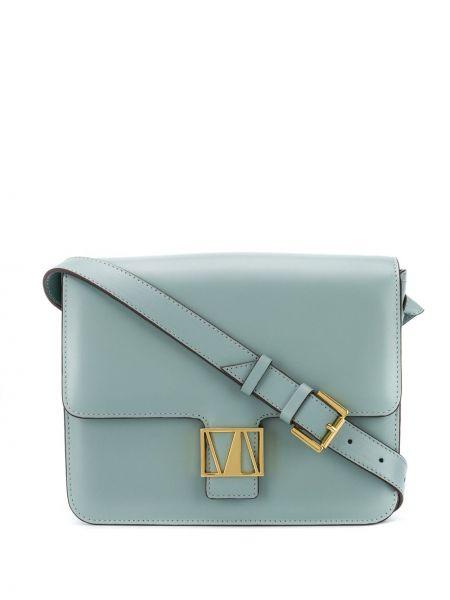 Золотистая с ремешком синяя сумка через плечо металлическая Manu Atelier