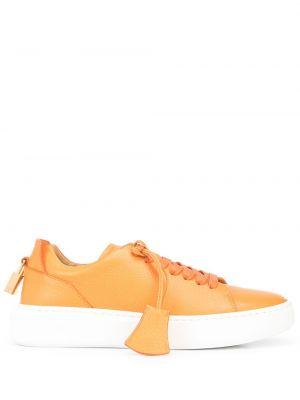 Pomarańczowe sneakersy skorzane Buscemi