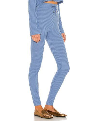 Prążkowane niebieskie legginsy Camila Coelho