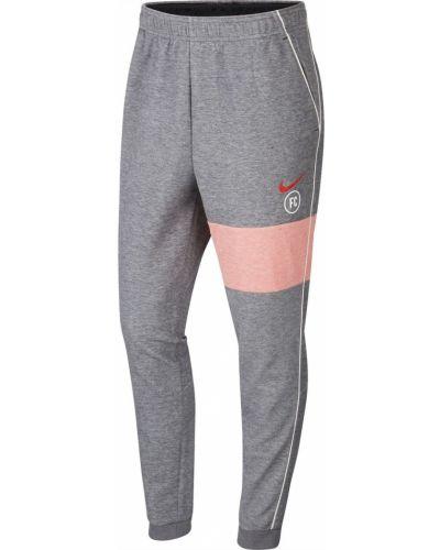 Szare spodnie casual Nike