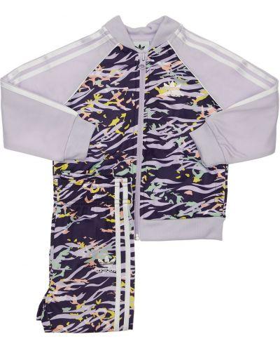 Fioletowe spodnie w paski z printem Adidas Originals