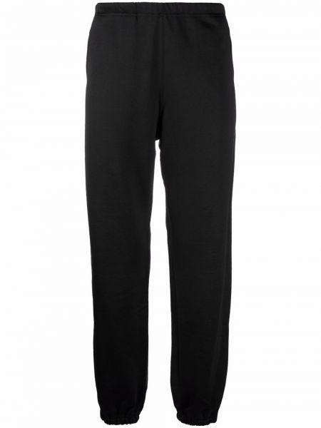 Czarne spodnie z haftem Needles