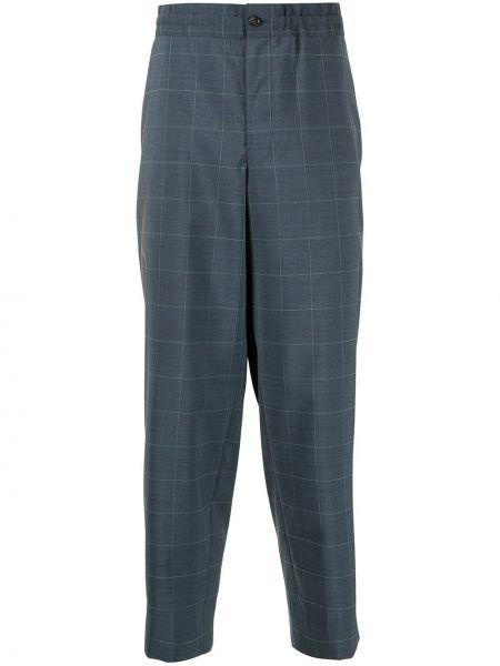 Niebieskie spodnie wełniane z printem Comme Des Garcons Homme Deux