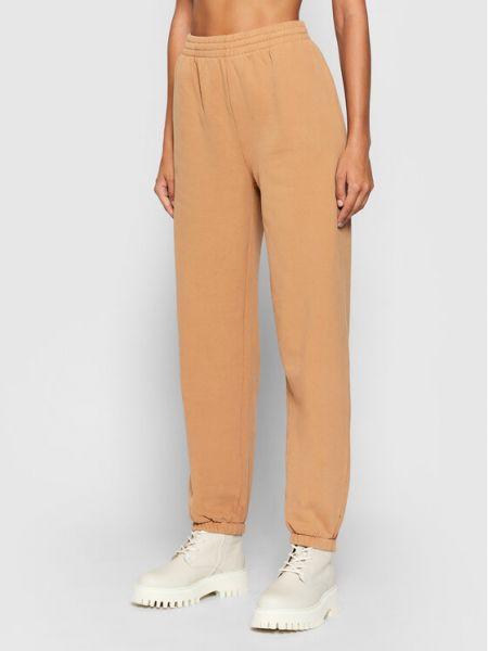 Pomarańczowe spodnie dresowe Kontatto