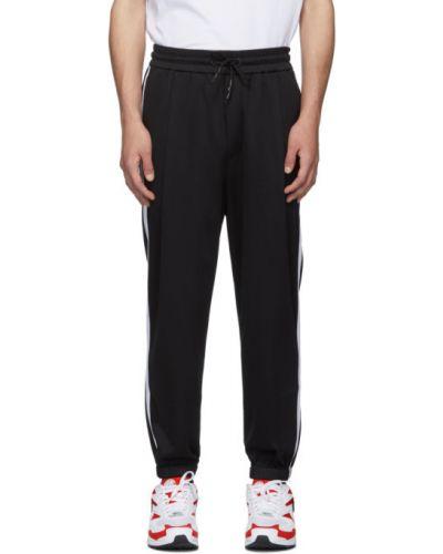 Czarny fajki do spodni z kieszeniami z łatami z mankietami Mcq Alexander Mcqueen