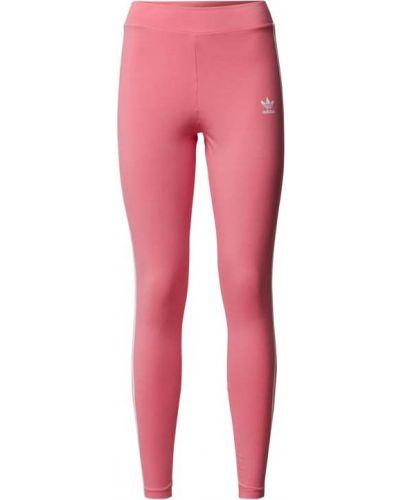 Różowe spodnie w paski Adidas Originals