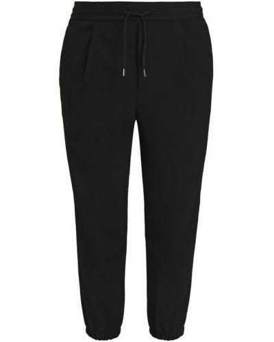 Укороченные брюки шерстяные с карманами Mcq