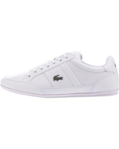 Белые кроссовки на тонкой подошве Lacoste