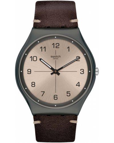 С ремешком кожаные часы на кожаном ремешке золотые Swatch