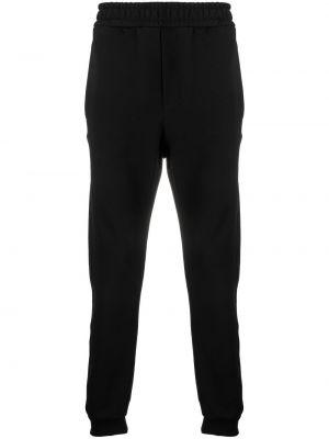 Czarne spodnie bawełniane z printem Omc