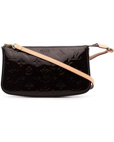 Złota kopertówka Louis Vuitton
