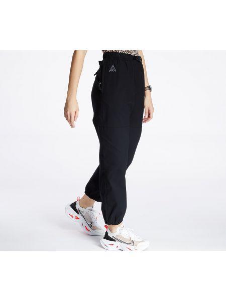 Брендовые черные брюки Nike