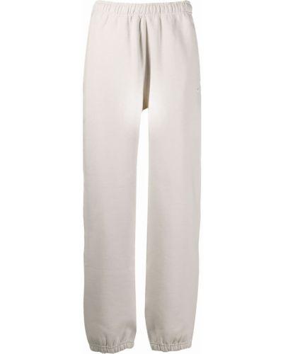 Beżowe spodnie bawełniane Nike