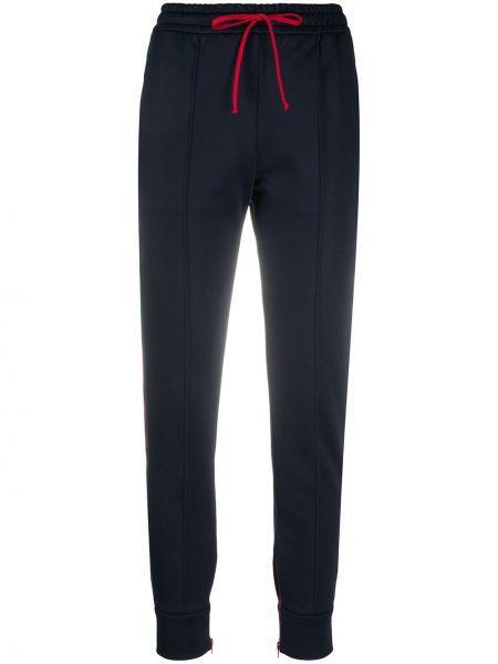 Ze sznurkiem do ściągania zielony bawełna sportowe spodnie z haftem Gucci