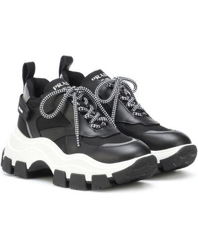 Кожаные кроссовки черные Prada