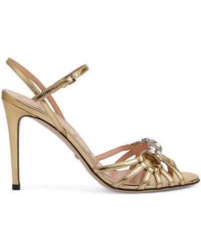 Złote sandały klamry peep toe Gucci