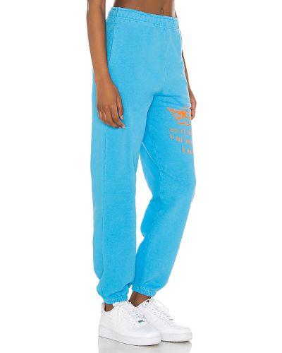 Niebieskie joggery bawełniane z printem Boys Lie