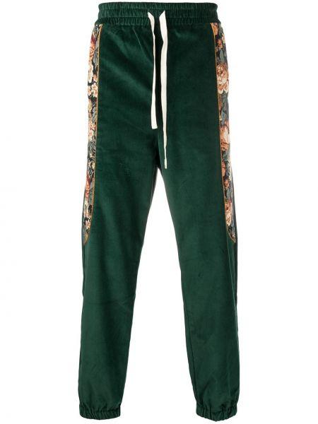 Prążkowane zielone spodnie bawełniane Drole De Monsieur