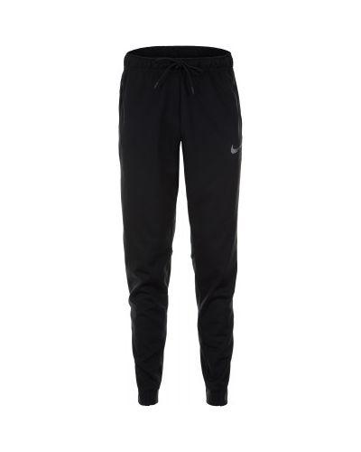 Спортивные брюки зимние с карманами Nike