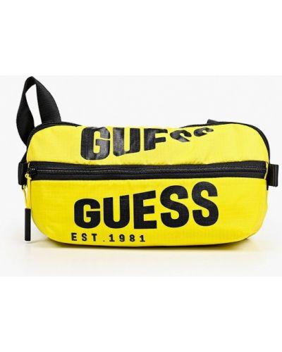 Желтая поясная сумка Guess