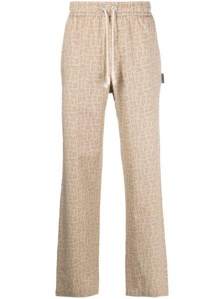 Beżowe spodnie bawełniane z printem Palm Angels