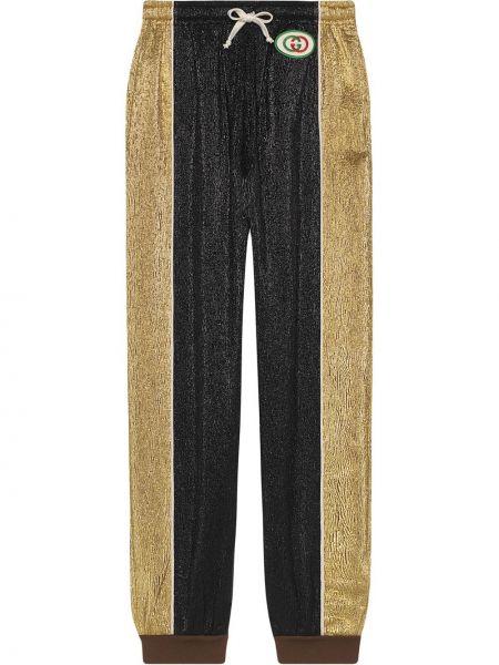 Złote czarne majtki do biegania Gucci