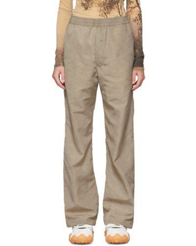 Beżowe spodnie z printem Serapis