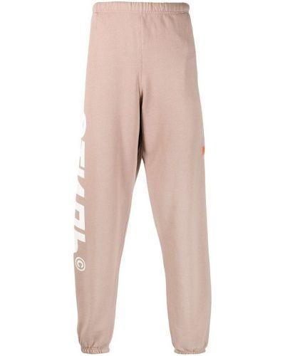 Beżowe spodnie dresowe Heron Preston