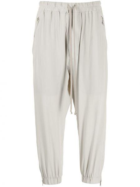 Beżowe spodnie z jedwabiu Rick Owens