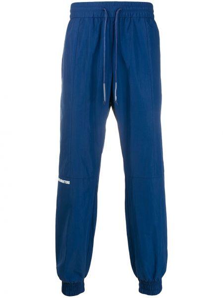 Синие зауженные брюки с манжетами с карманами бязевые Wwwm