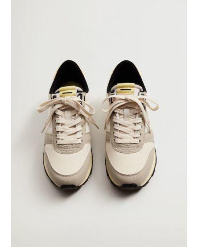 Żółte sneakersy Mango