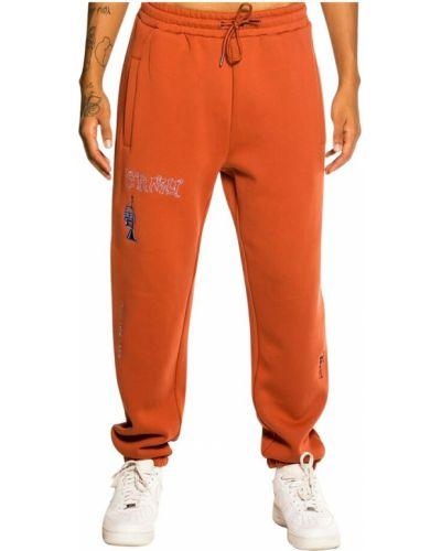 Pomarańczowe joggery Grimey