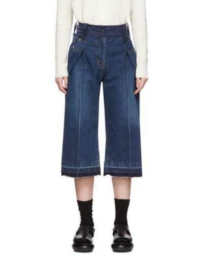 Niebieski jeansy do kostek z mankietami z kieszeniami zapinane na guziki Sacai