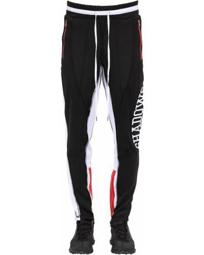 Czarne spodnie z haftem Renowned La