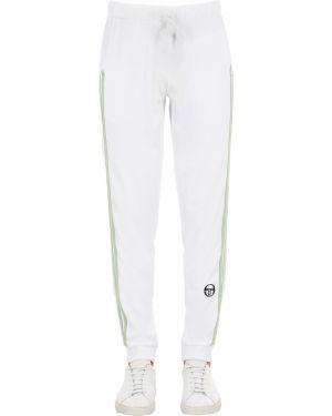 Białe joggery w paski z haftem Sergio Tacchini