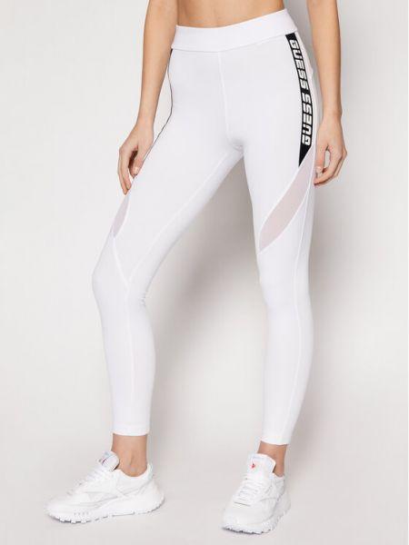 Białe legginsy Guess