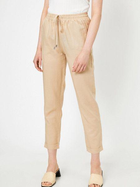 Повседневные бежевые брюки Koton