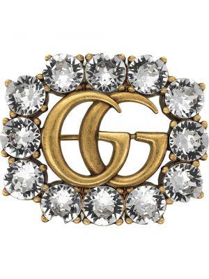 Broszka na łańcuchu metal Gucci