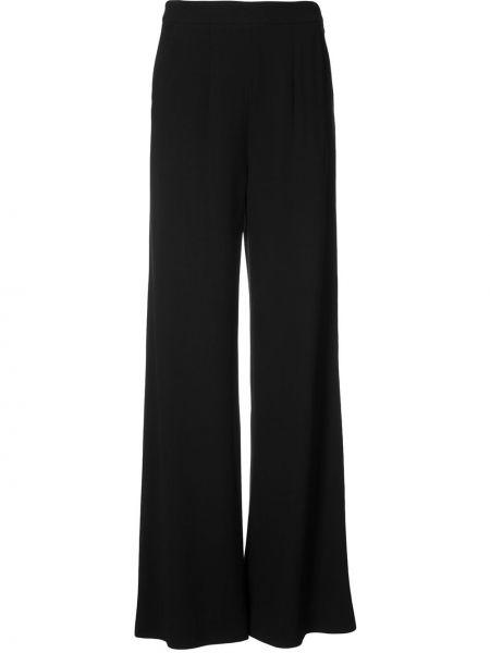 Черные расклешенные брюки Josie Natori