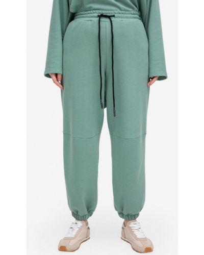 Зеленые спортивные брюки Lessismore