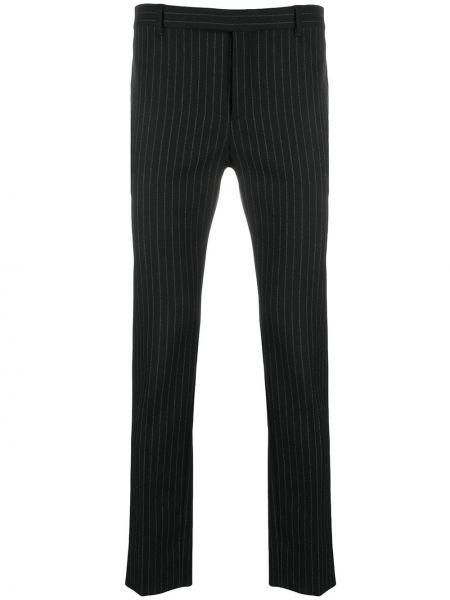 Wełniany czarny spodnie z paskiem zapinane na guziki Saint Laurent