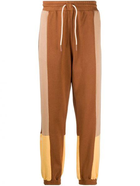 Brązowe spodnie bawełniane z printem Drole De Monsieur