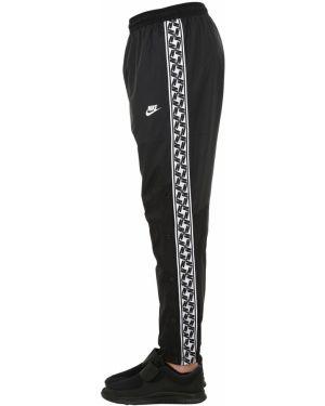 Спортивные брюки с карманами с поясом Nike
